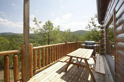 Main Level Deck with Picnic Table and Grill at Over The Rainbow