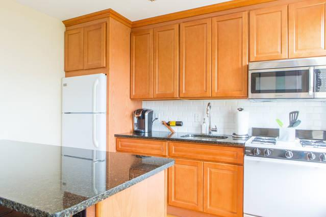 Brand new eat-in kitchen with a complimentary bottle of wine and a Keurig Coffee Machine.