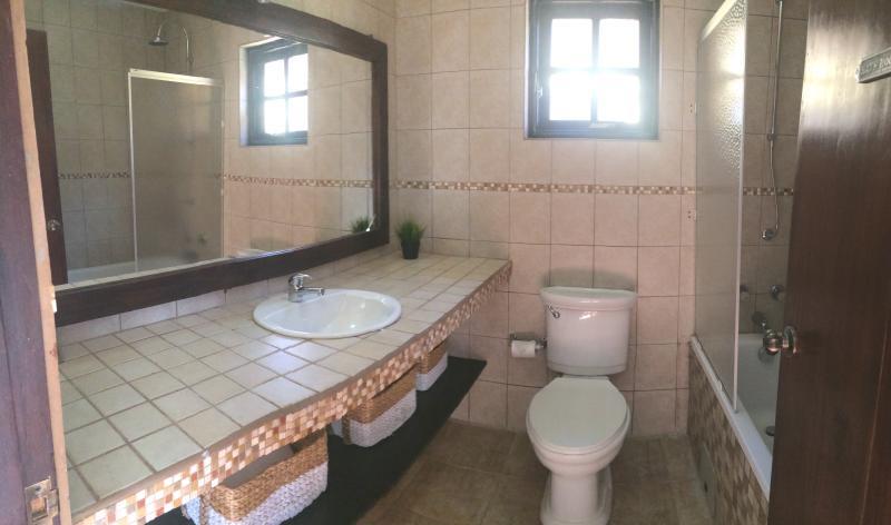 Masterbathroom with sink, shower and bathtub