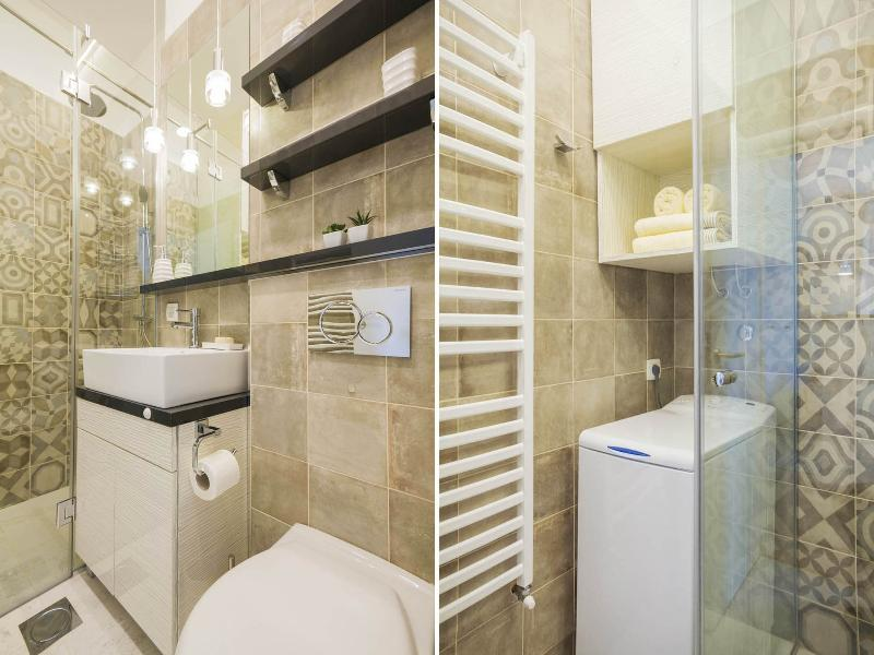 Brand new bathroom with walk-in shower, washing machine & drying rack, and a hairdryer.