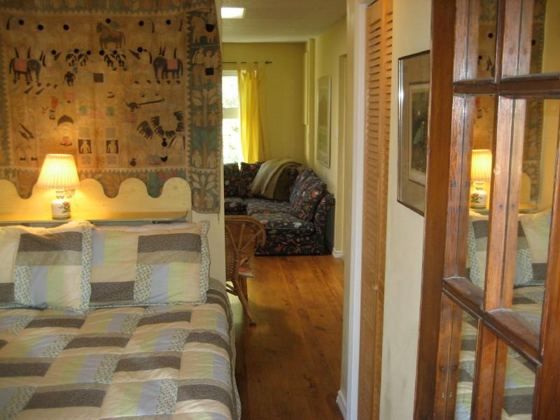 Double bed with deck walkout,  2pc  bathroom, and adjascent TV room/den. Can be like private suite.