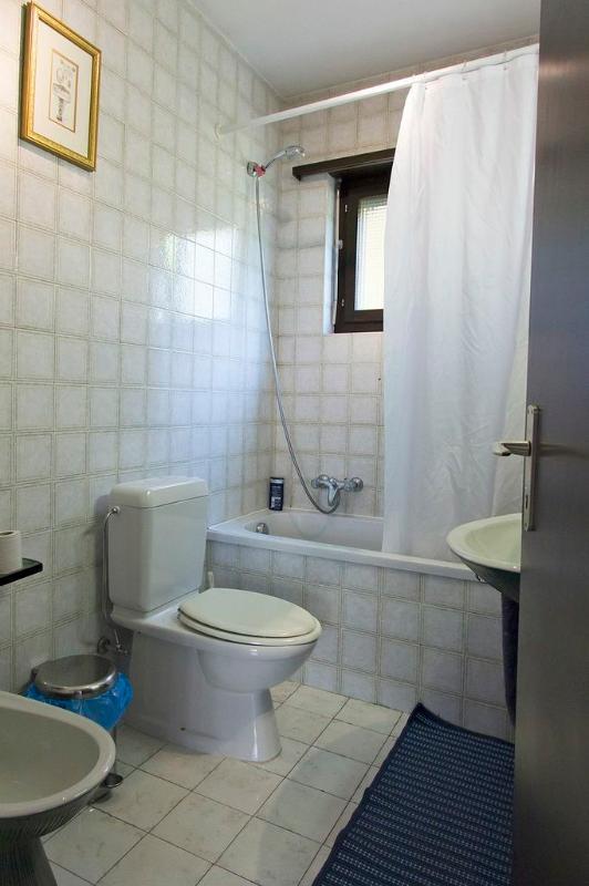 Bathroom has shower screen, new window & sink since this photo was taken.