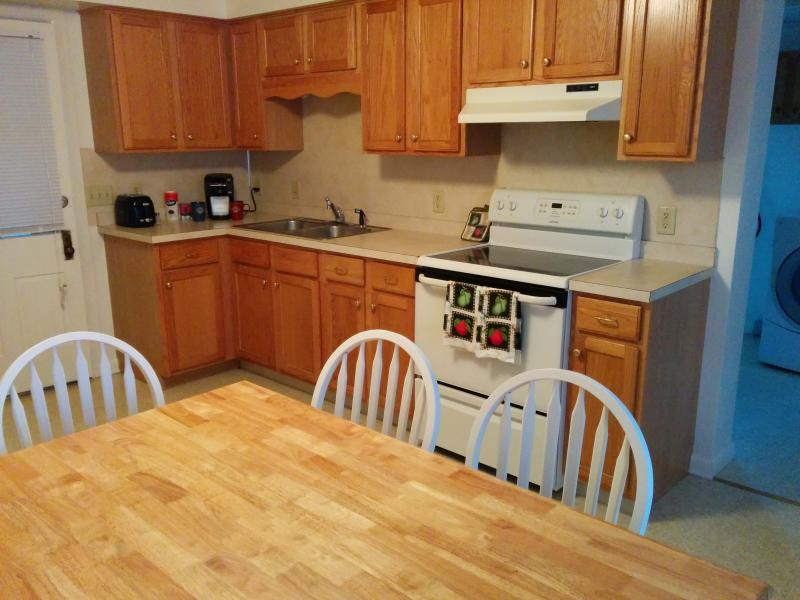 The kitchen has an eat in table for 6 plus four in the dining room. Full sized washer/dryer here.