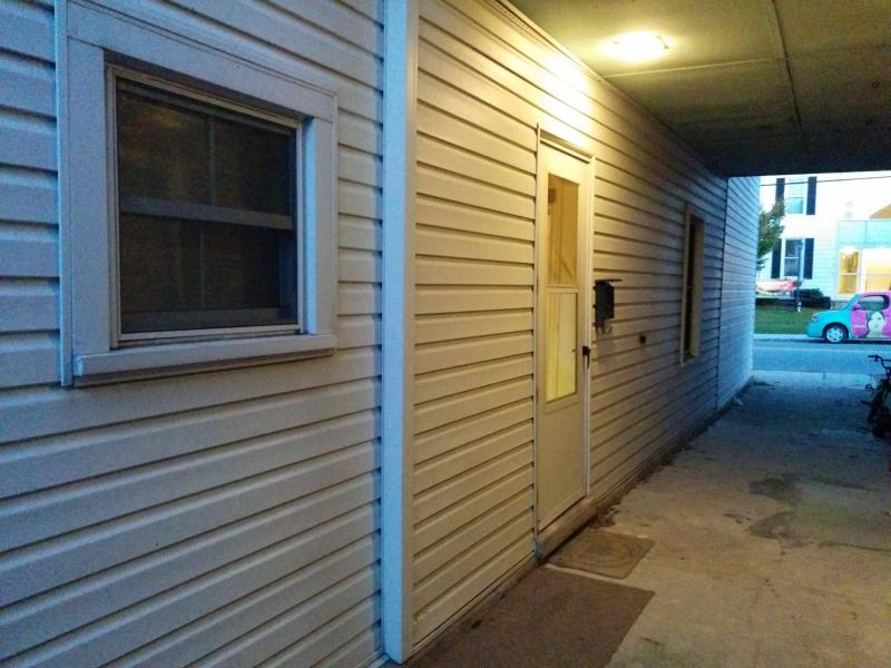 Side covered porch and door into kitchen - easy access from back parking area.