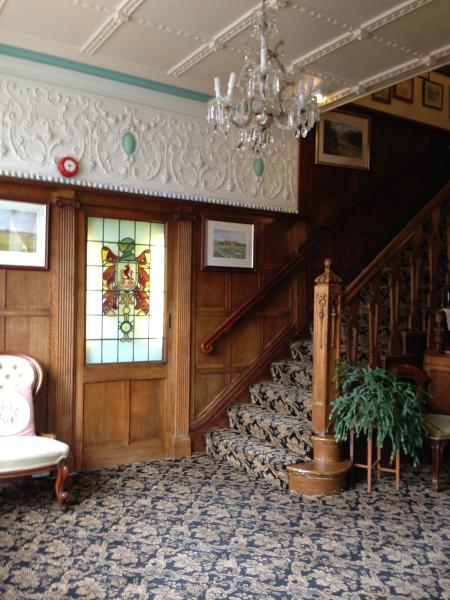 A large Oak panelled hallway greets you to our family run home with private suites