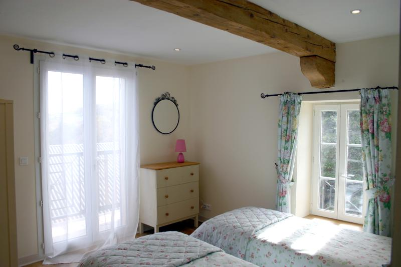 The second bedroom of Calmont leading onto its own balcony