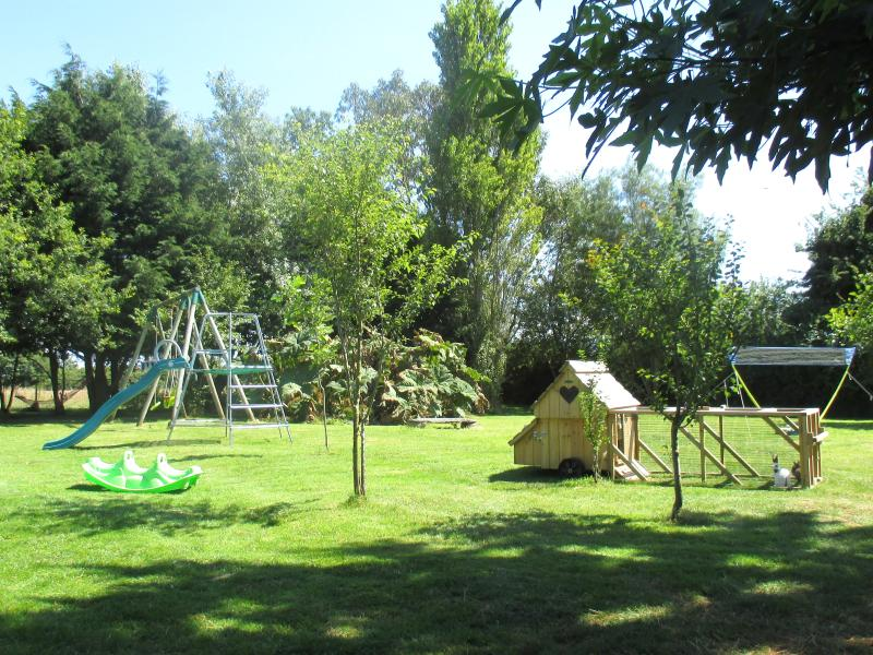 The huge shared garden has a play area for children and animals to feed