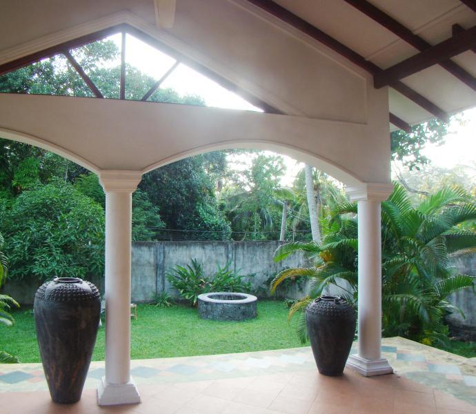 Veranda looks onto front, walled garden.