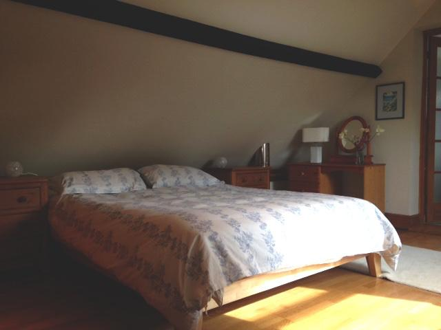 Double bed upstairs in the roof space