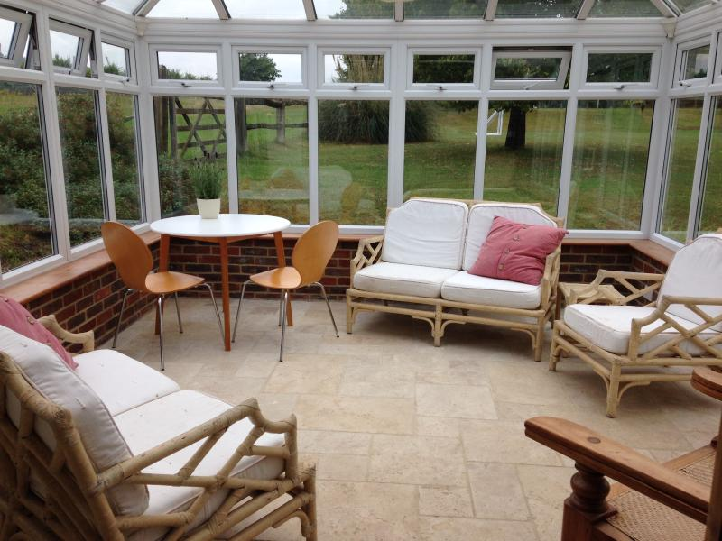 Conservatory with dining area and views of the garden