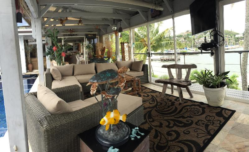 Lounge area on deck next to pool and overlooking marina