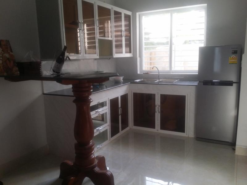 Modern kitchen with granite worktops  has large windows over the sink...a British norm...