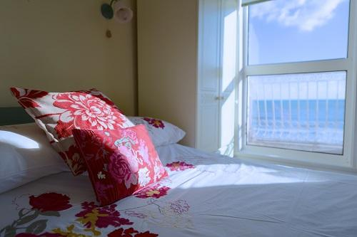 view of the ocean from your bed