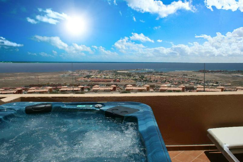 Enjoy the view, a glass of wine and relax in the large steaming 5 seater hot-tub.