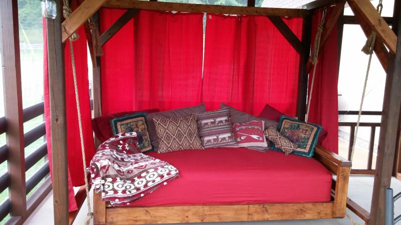 Swinging Bed on the screen porch
