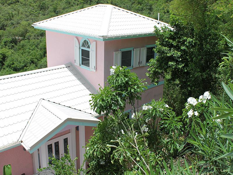 Colorful Villa Jumbie - perched on the Hillside in Coral Bay