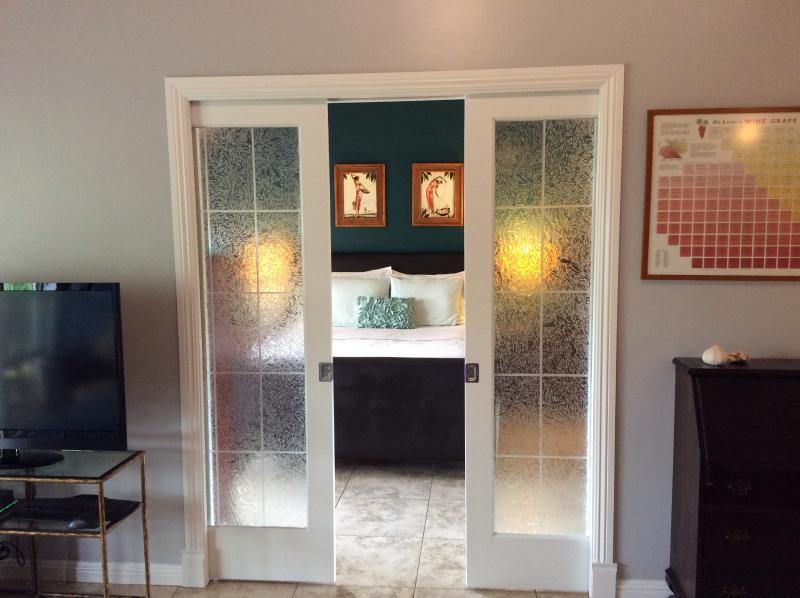 Bedroom privacy - Large flat screen TV in livingroom