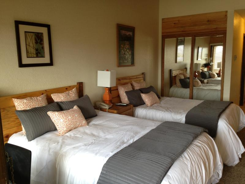2 full beds in  main floor bedroom. This bedroom has its own full bathroom and private entrance