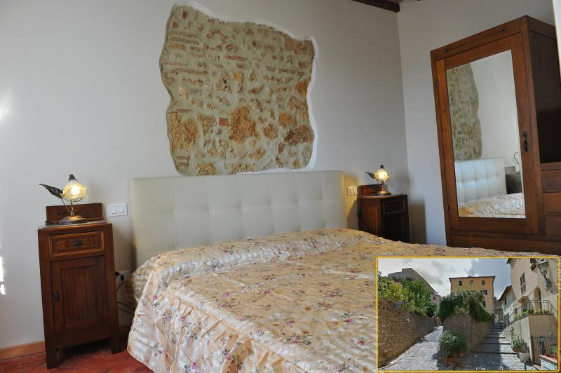 master bedroom Tuscan-style preserved as it was then with the original materials.