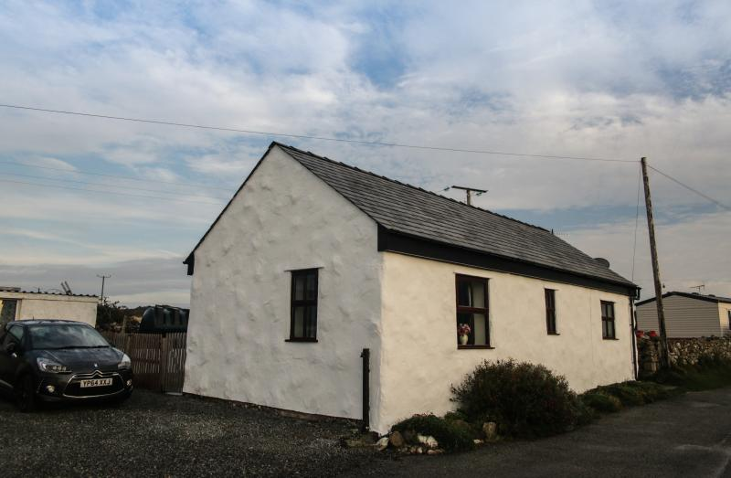 The cottage viewed from the road showing 2 parking spaces