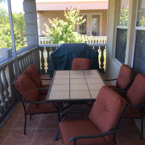 Screen covered lanai with BBQ and view of the canal