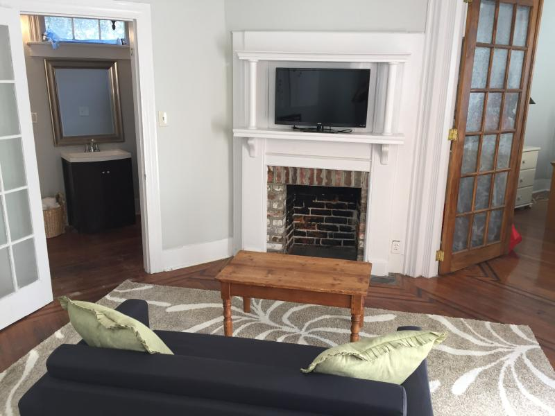 living rm with fireplace, flat screen, and 2nd full bath