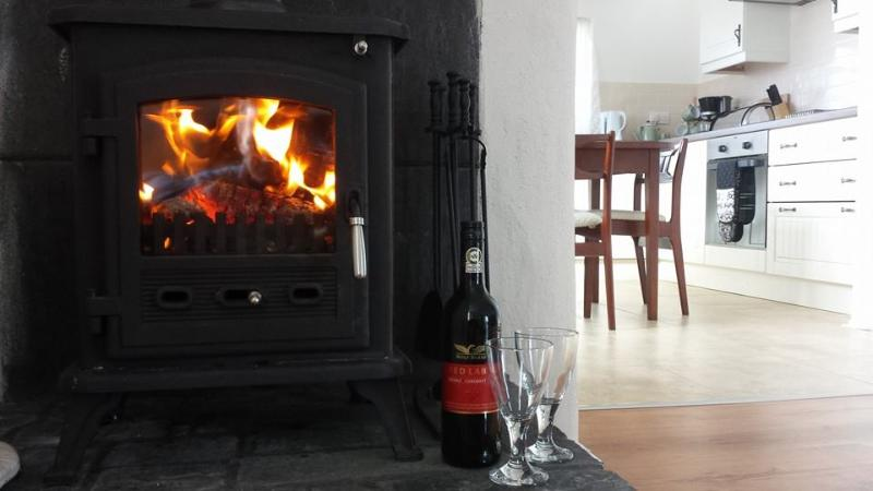 Real wood burning stove to warm your feet.