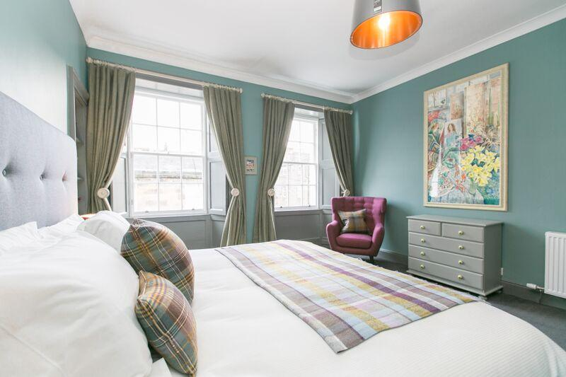 More original Scottish art and a mix of contemporary furniture with Scottish tartans.