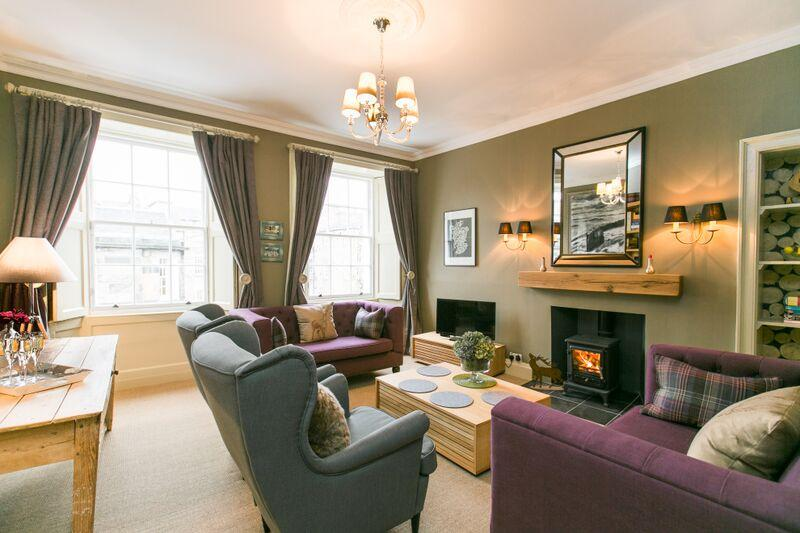 Gorgeous sitting room with wood burner and Scottish art and fabrics aplenty