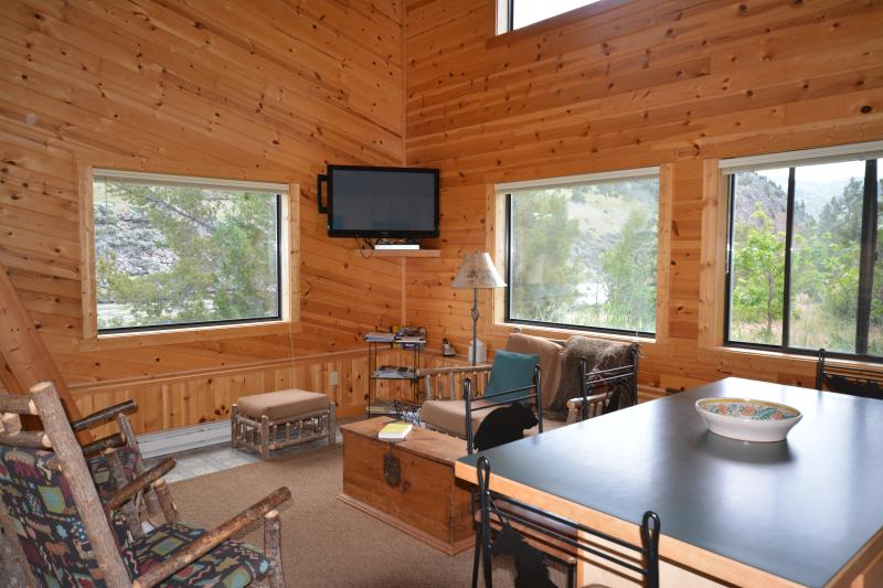 Living room with 48' flatscreen TV with Dish Network programming. View of Yellowstone River.