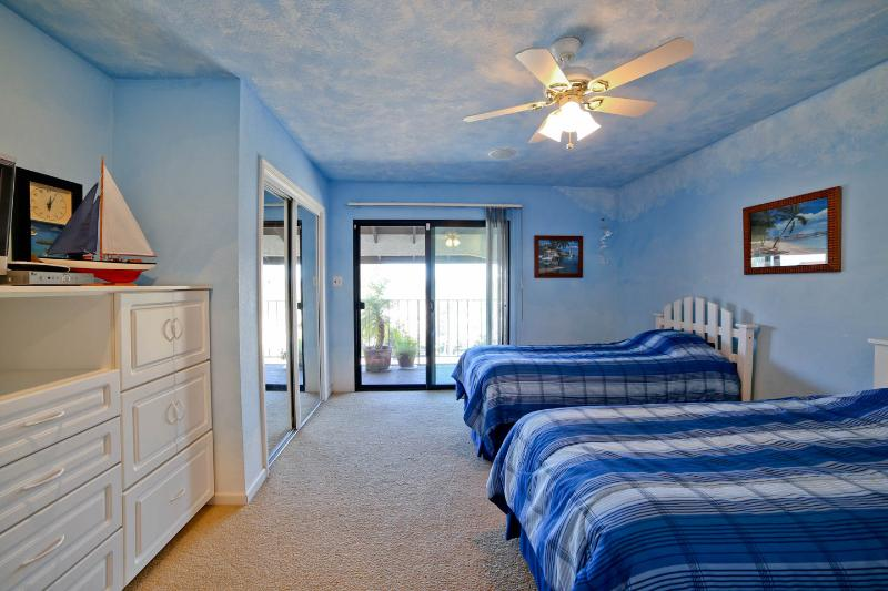 West Coast Villa I Cloud Room with two twin beds and access to second floor balcony