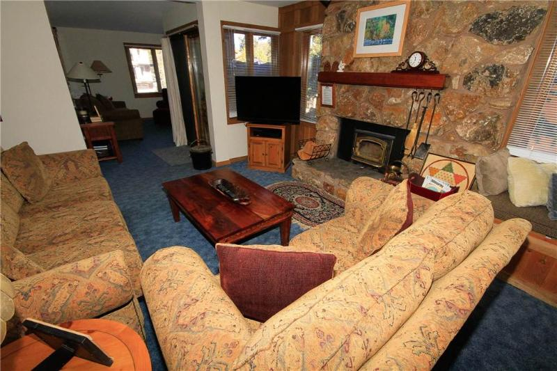 Couch,Furniture,Entertainment Center,Fireplace,Hearth