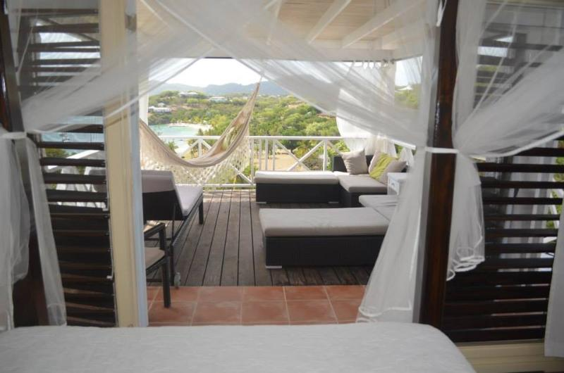 Guest bedroom 4 or use as day bed with mini fridge and opening on 3 sides onto pool/balconies/cabana