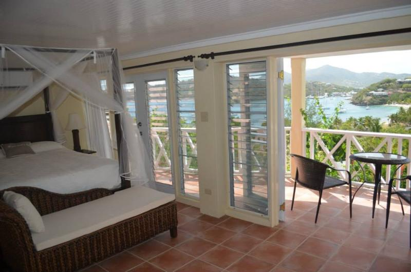Lower floor Master Bedroom Suite 2 with mini fridge, adjoining bedroom, large balcony with sea view