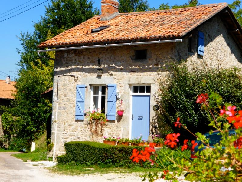 La Noix is pretty as a picture with blue shutters and big oak door