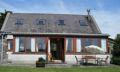 Front of the cottage Enjoy the sunny aspect and lovely view over the countryside