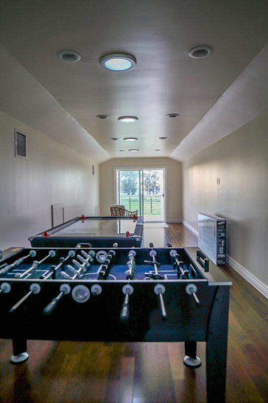 Game room with foosball and air hockey table.  Not shown: Flat screen TV, A/C, sofa bed