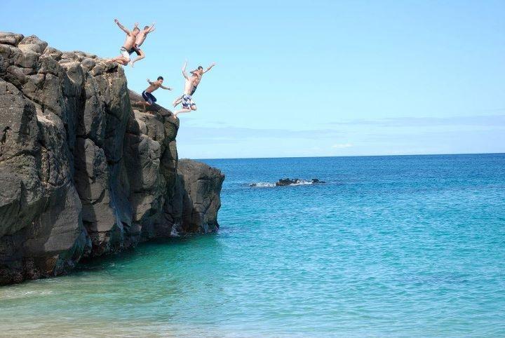 Jump off the Waimea Bay rock!