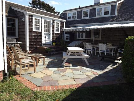 Furnished Patio with Awning and Gas Grill