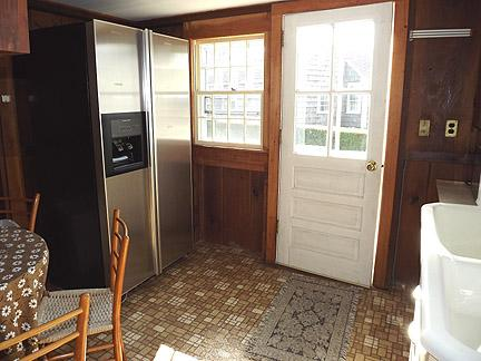 Cottage Kitchen with Sink, Refrigerator and Microwave