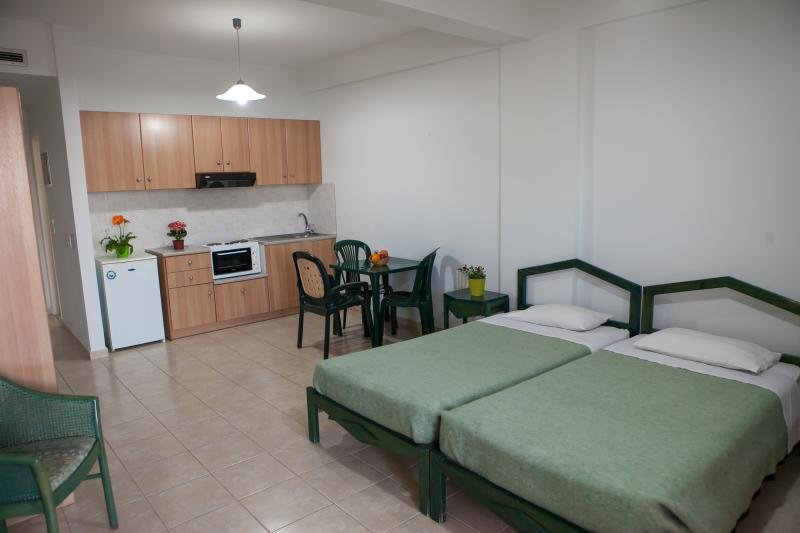 Twin beds and kitchenette/dining area