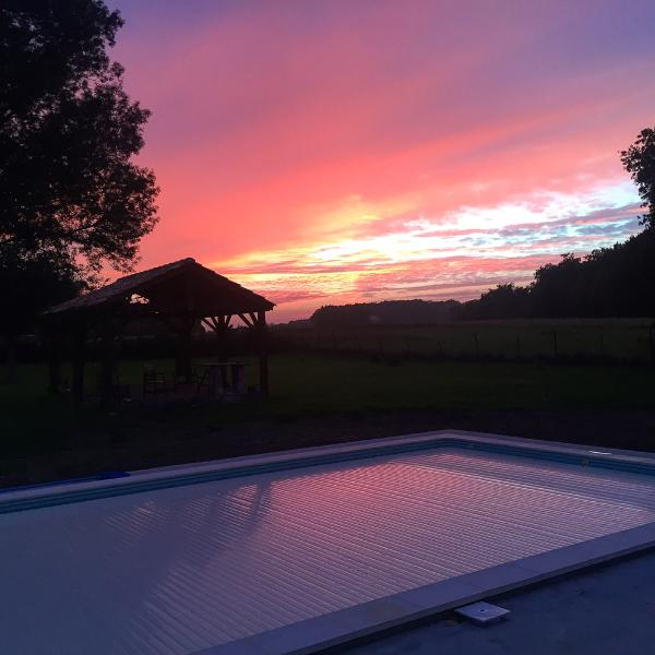 Sunset over the securely covered swimming pool