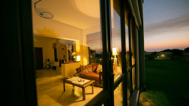 Night view of the living room from outside - Villa Russelia in Rhodes