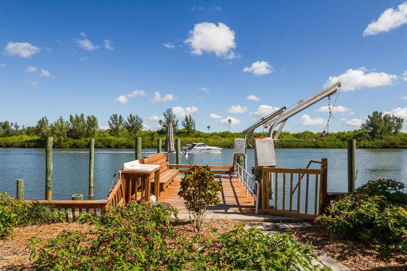 Watch boats, dolphins, birds from your private dock