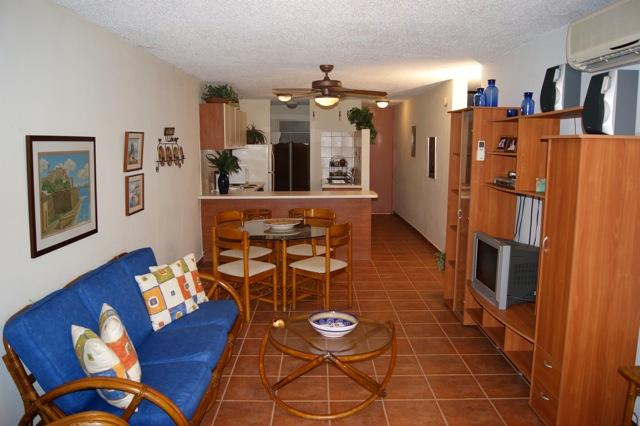 Living room has A/C, TV, WiFi and direct access to private balcony/garden.