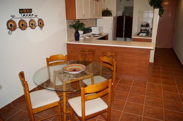 Dining table seats 4.  Two stools at kitchen counter.
