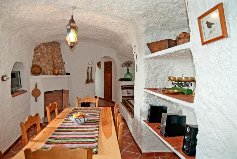 Living-dining room with fireplace of the Torriblanco cave.