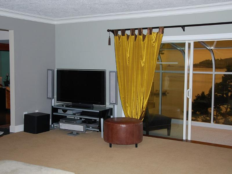 Sony flat screen TV, Blu ray player, surround sound.  Living room attached to sun room