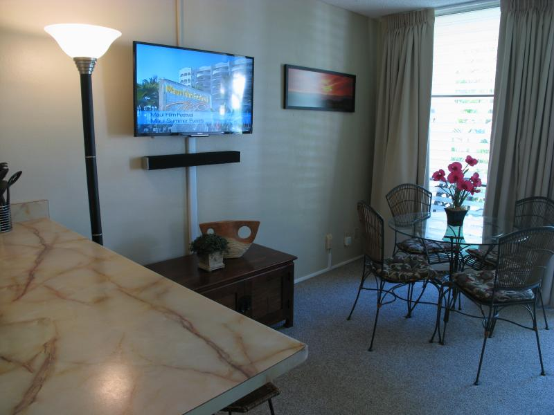 Dining area w/ Sony flat screen LED Smart HDTV and wall mounted Vizio Sound Bar.
