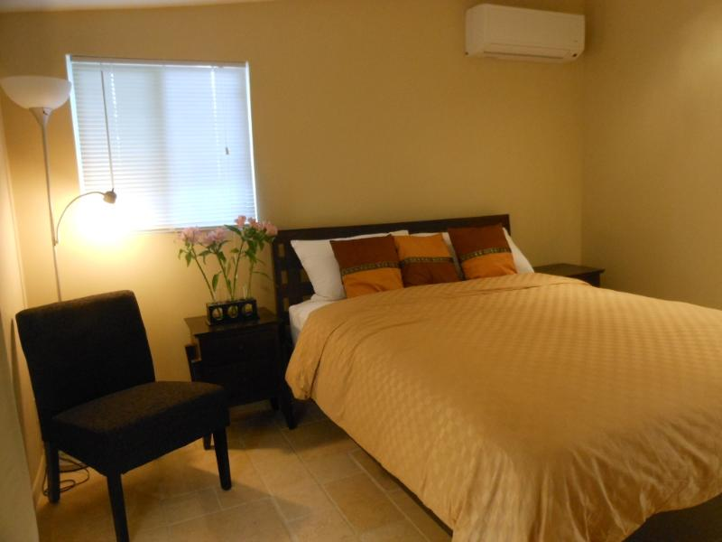 Queen size bed with 100% cotton bed linens. Ensuite bathroom, closet, small fridge, safe, desk, TV.